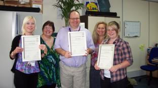 CAREGivers receiving their City & Guilds accredited awards in Alzheimer's and Other Dementias