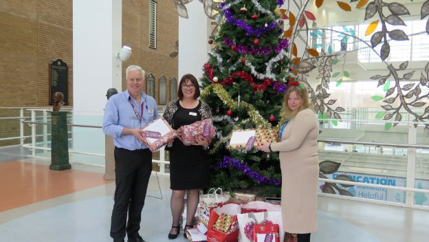 Donating Christmas presents to local hospital.