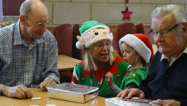 Home Instead \'Elves\' play Santa to Seniors