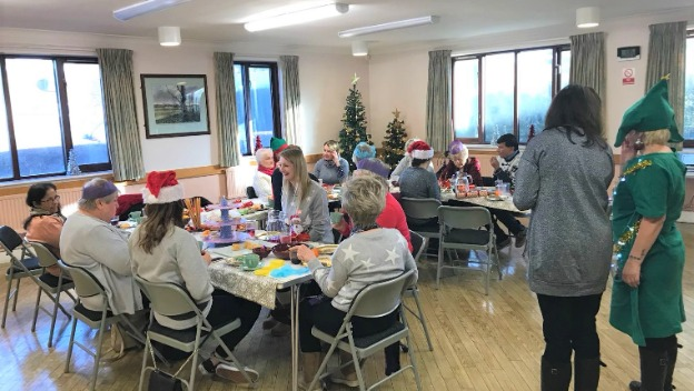 Home Instead brings together their elderly clients and their CAREGiver for a Christmas Party