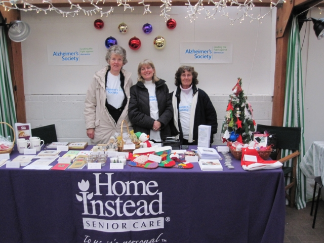 Katherine, Amanda and mum Enid with the Home Instead stall