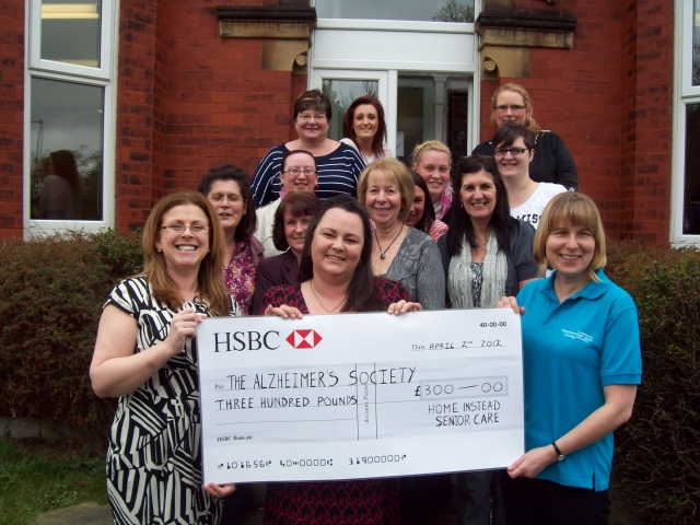 Irene and Anthea  present their cheque to Alzheimers Society