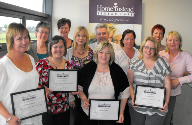 Debra (front, right) with other newly trained managers