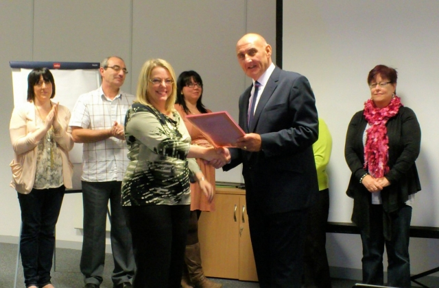 Debra receives her Dignity & Dementia Award from Cllr Harrison