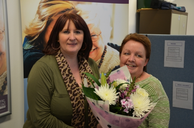 Cath receiving her award from Care Manager, Michele