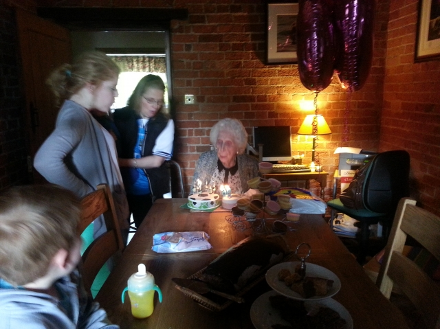 Gran blowing out the candles