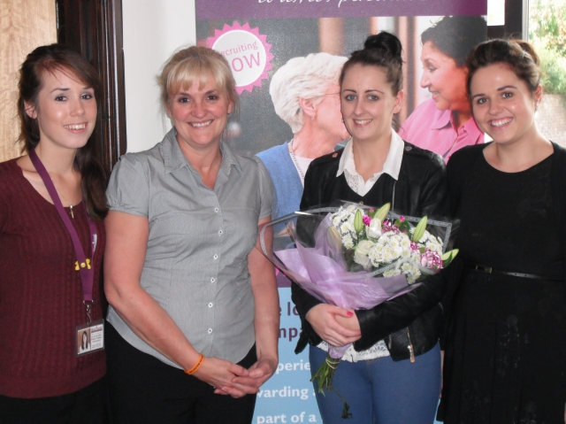 Claire collects her flowers from Gail with Natalie & Sam