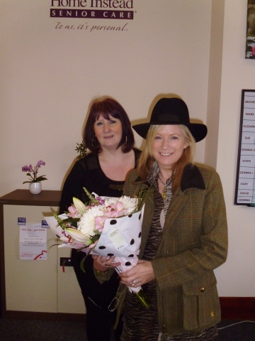 Caroline receiving her award from Care Manager Michele