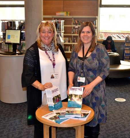 Home Instead Donate Care Books to Norfolk Millennium Library