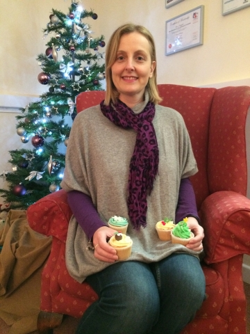 Becky with a selection of her Christmas cup cakes