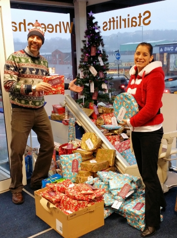Mick & Tara (Millercare manager) with some of the 230 presents