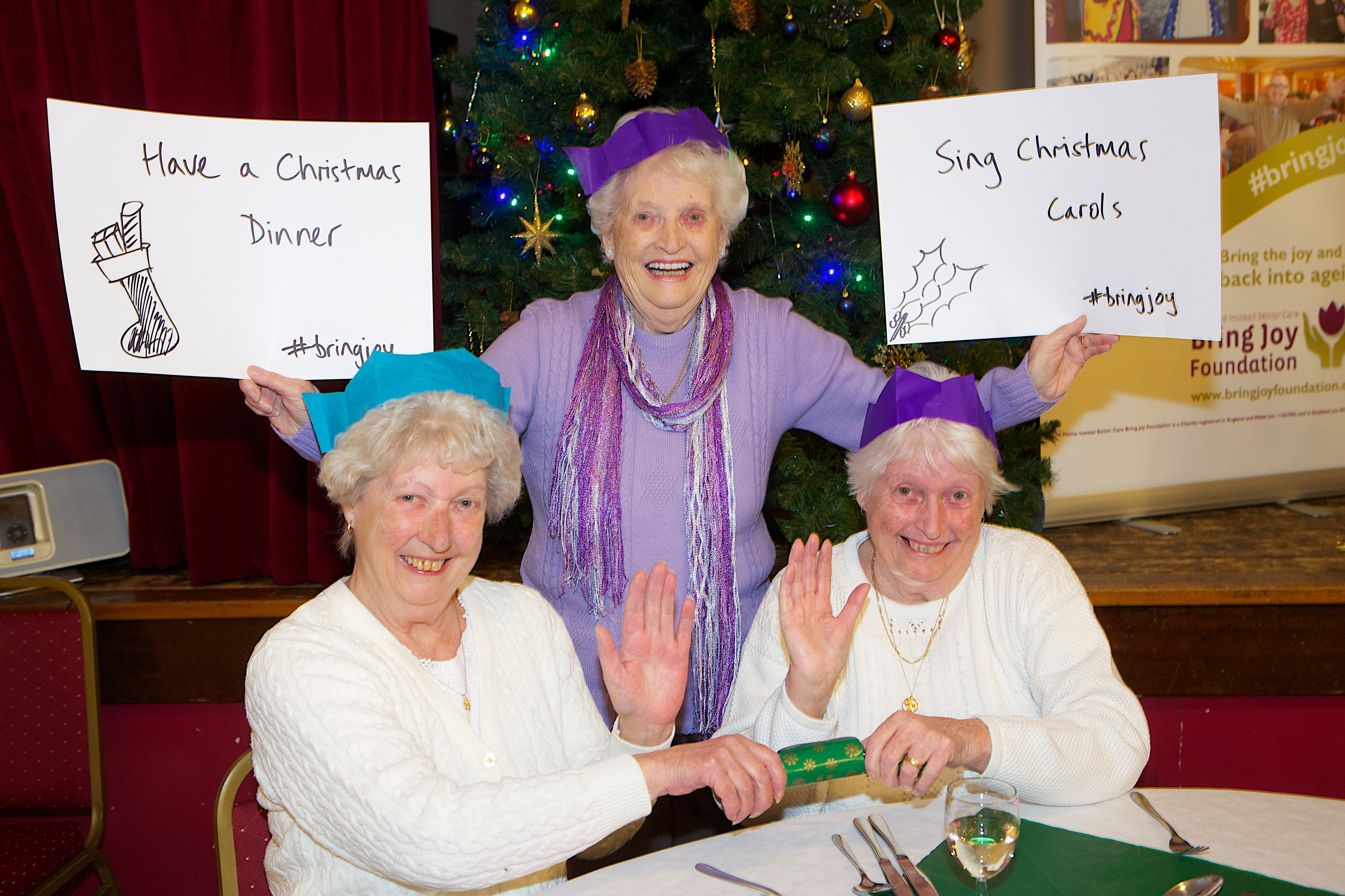 Kathleen Stubbs, Frances Blakemore and Christine Duffy with #bringjoy festive wishes on message boards