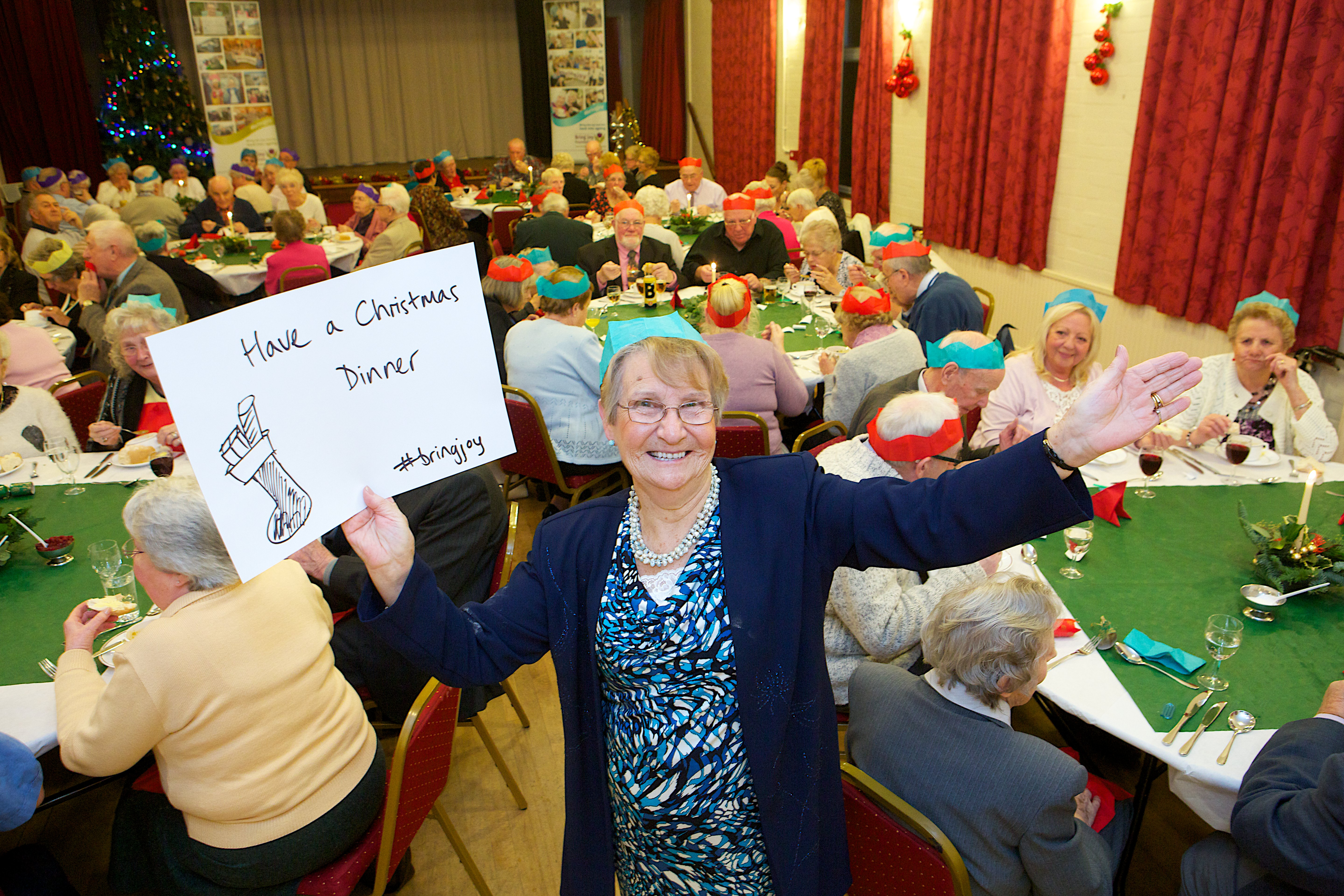 Sandbach resident Mary Goode with a #bringjoy festive wish on a message board