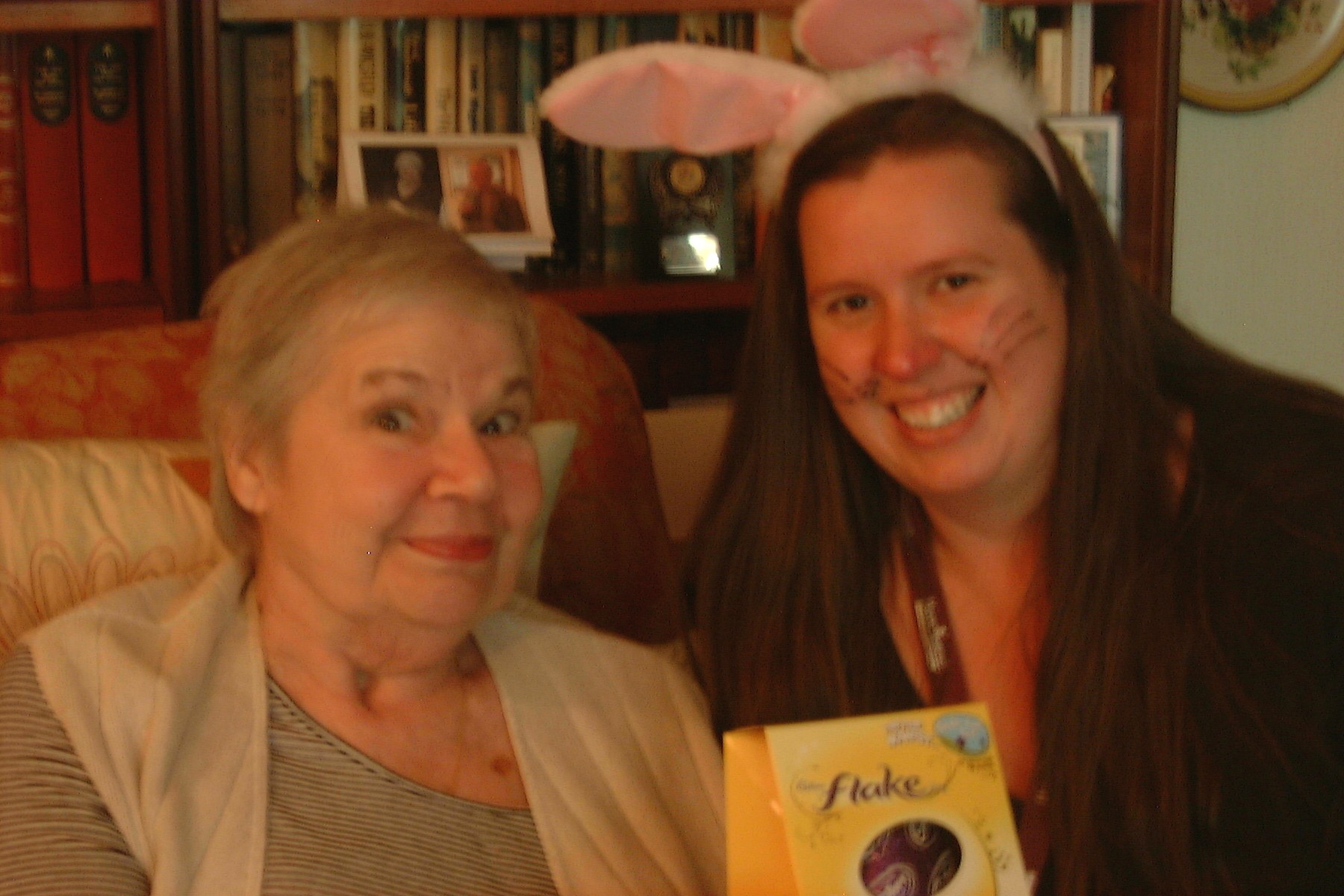 Home Instead Guildford and Woking CAREgiver Charlotte Leckie delivering Easter egg to elderly client Pauline Smith
