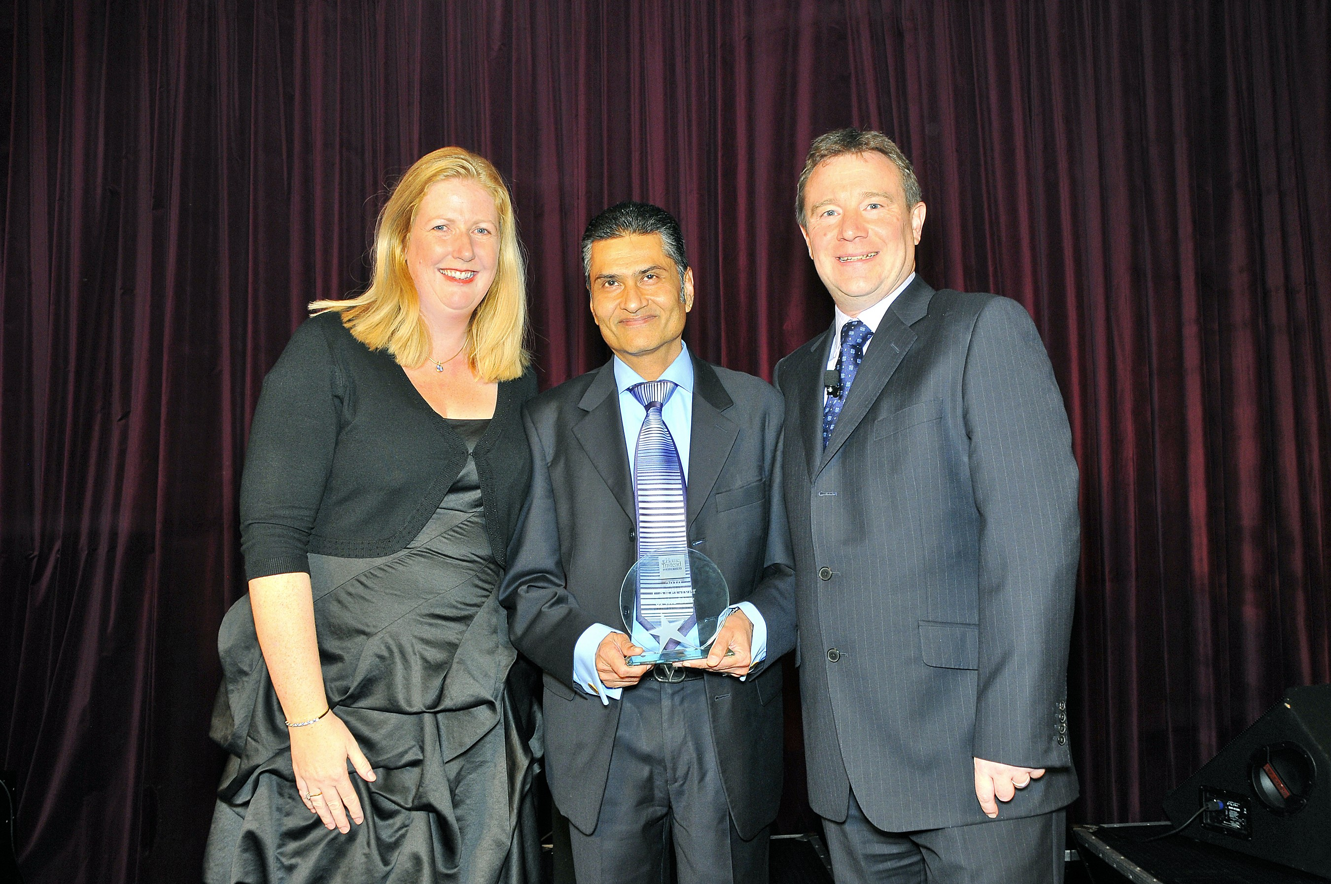 Home Instead Ealing CAREgiver Vyom Padania holding his 'Caregiver of the Year' award