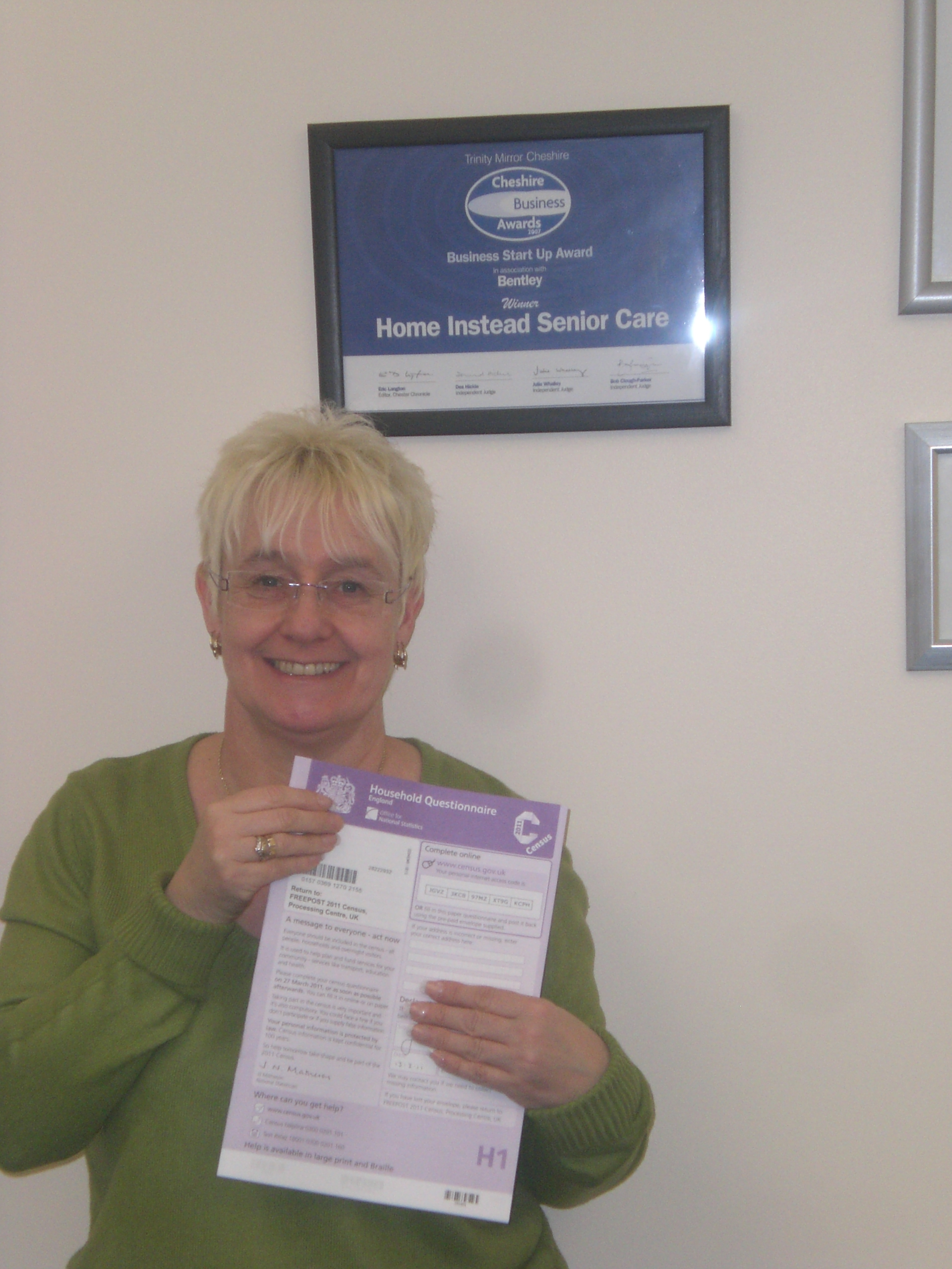 Home Instead Warrington elderly client holding one Census form