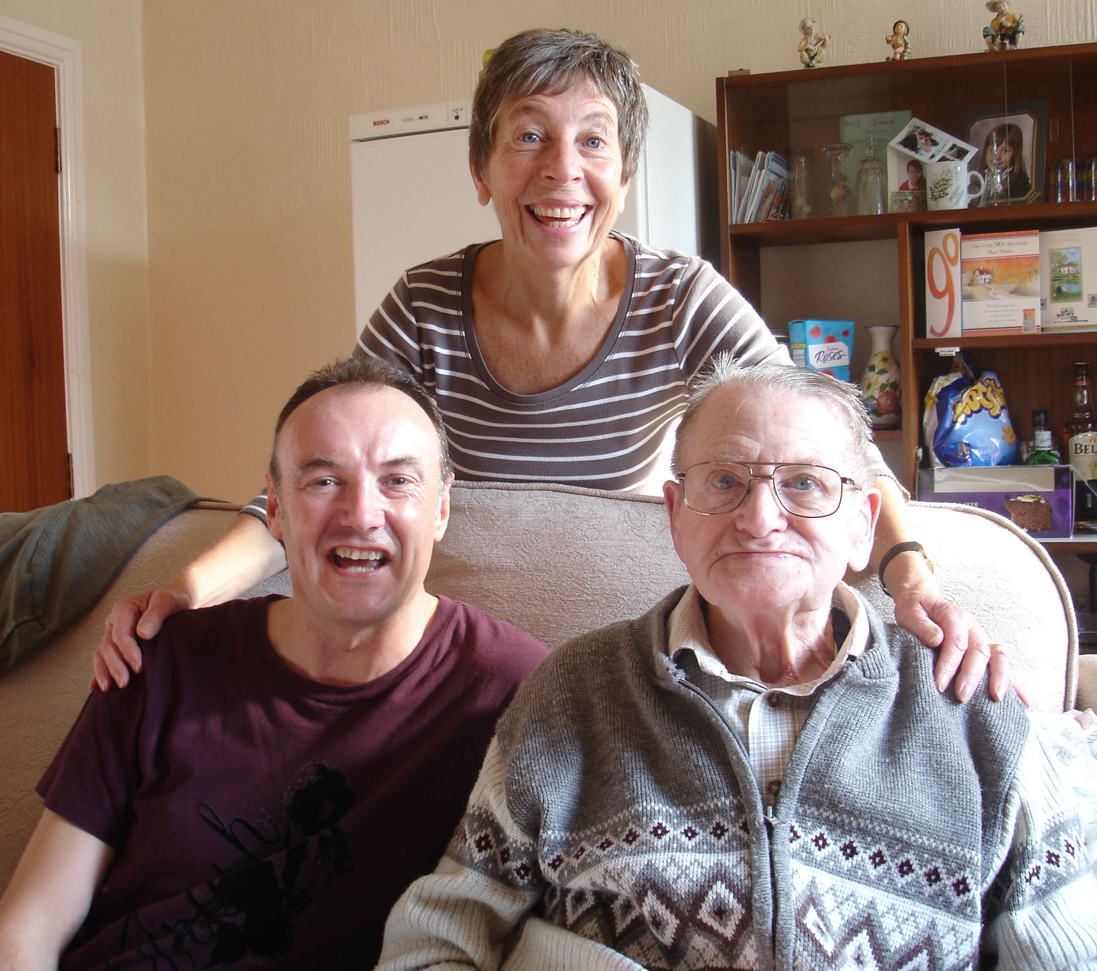Home Instead Sheffield CAREgiver Gary Eato providing a personal care visit to 90-year-old client Cyril Crookes and his daughter Sandra on his birthday