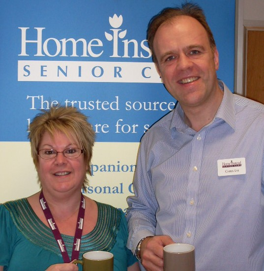 Home Instead Ipswich Care Manager Teri Wines and owner Chris Lye celebrating Dignity Action Day
