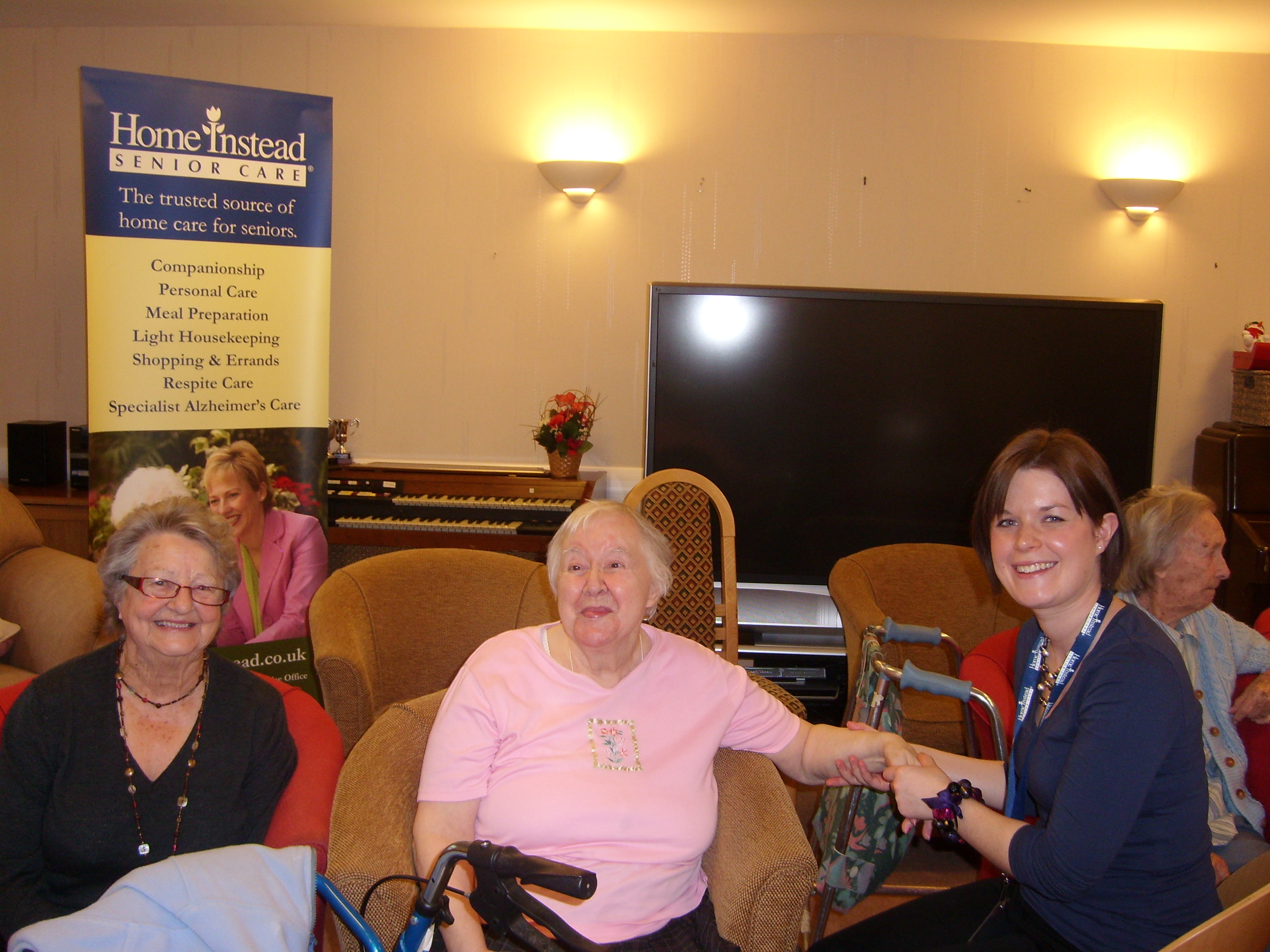 Sunnyfield Lodge residents receiving hand massages on the pamper day organized by Home Instead Senior Care Harrogate, Ripon and Thirsk
