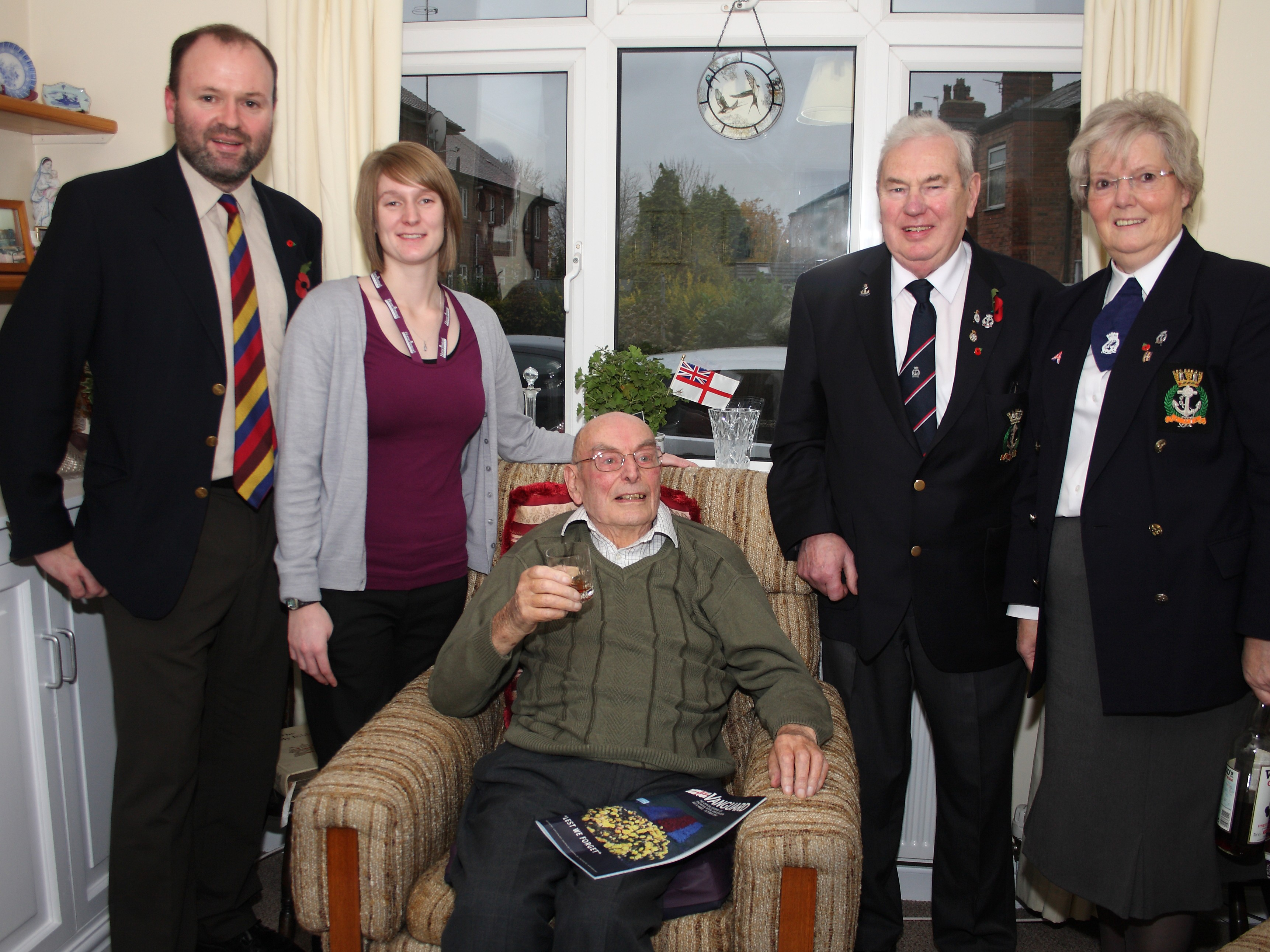 Home Instead Altrincham owner Alan Savage and team member Holly Brownlee, 88-year-old client Doug Barman and Trafford Royal Naval Association members Charles Hutton and Diana Hutton