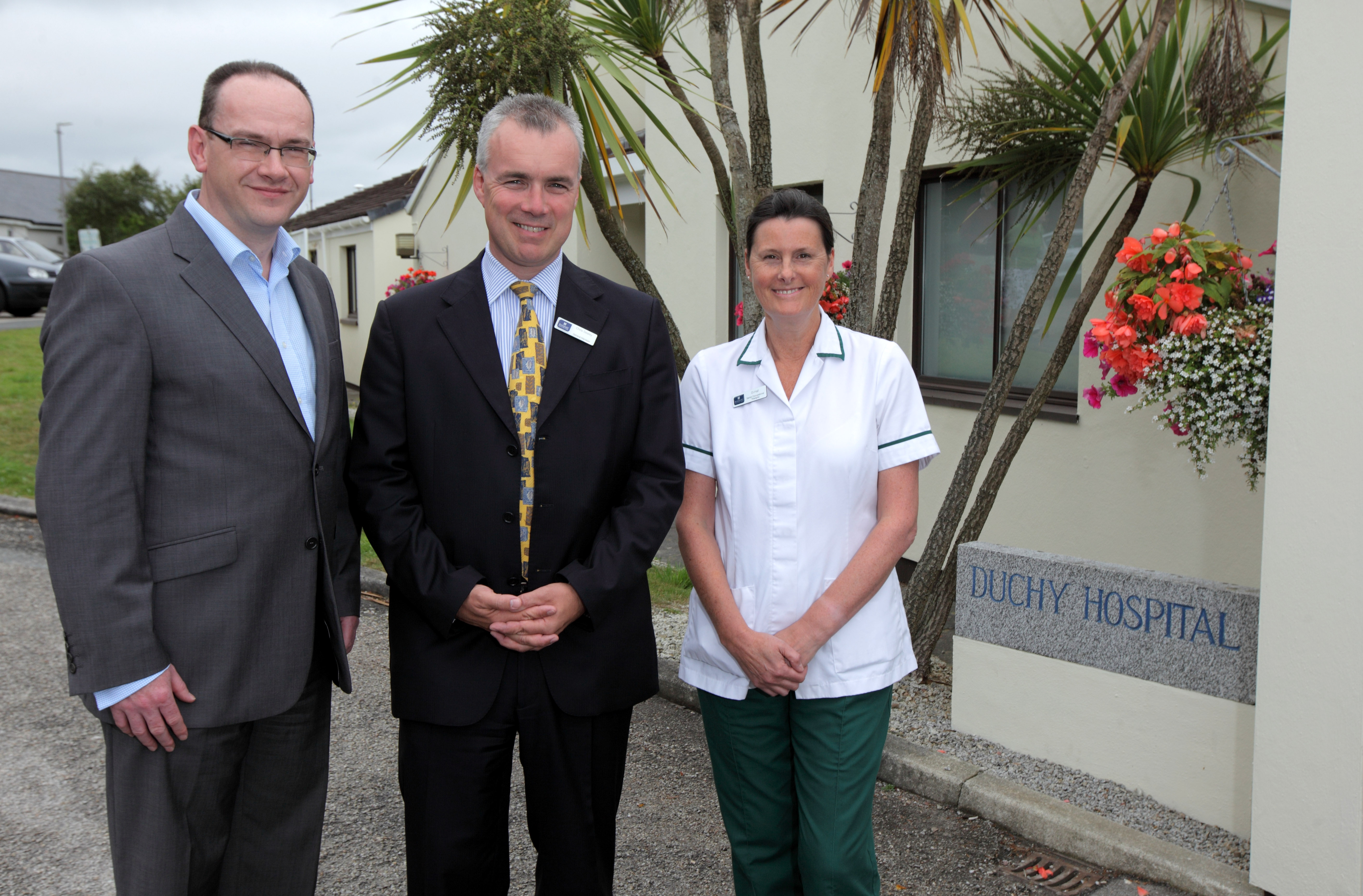 Duchy Hospital General Manager and team member next to Home Instead Truro owner