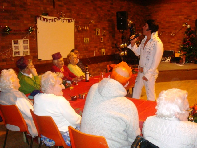 Elvis impersonator in front of Home Instead clients and members of the Nottingham Catholic Church