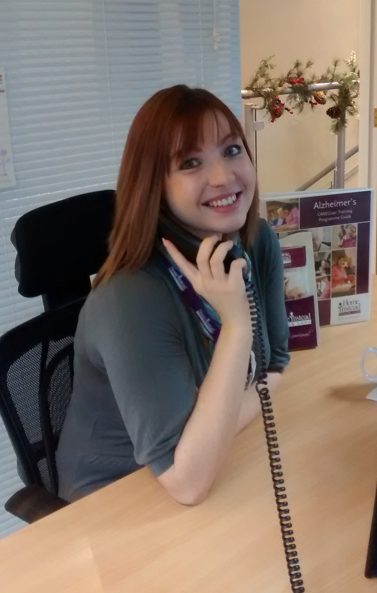 24-year-old CAREgiver Emma Needham at Home Instead Senior Care office in Oldham and Saddleworth