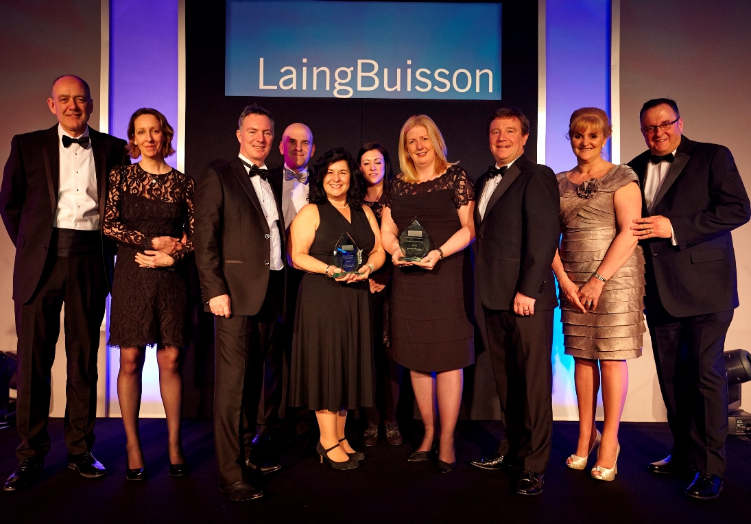 Home Instead Senior Care team holding their the Entrepreneur of the Year and the Early Intervention and Prevention awards at the Laing & Buisson Independent Specialist Care Awards