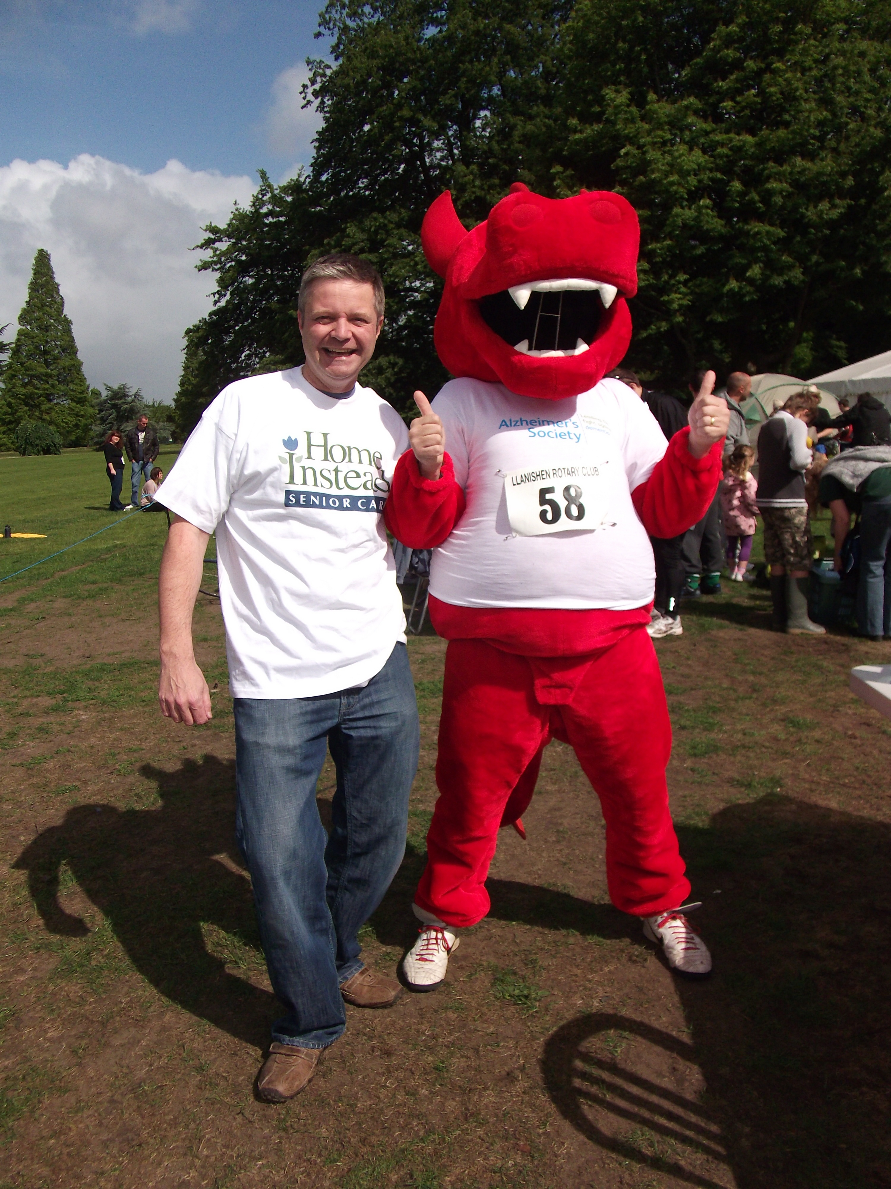 Phil Batchelor, director of Home Instead Cardiff, next to Stephen Westlake, a member of the local Llanishen Community Police team, who donated a the dragon costume for the Alzheimer's society