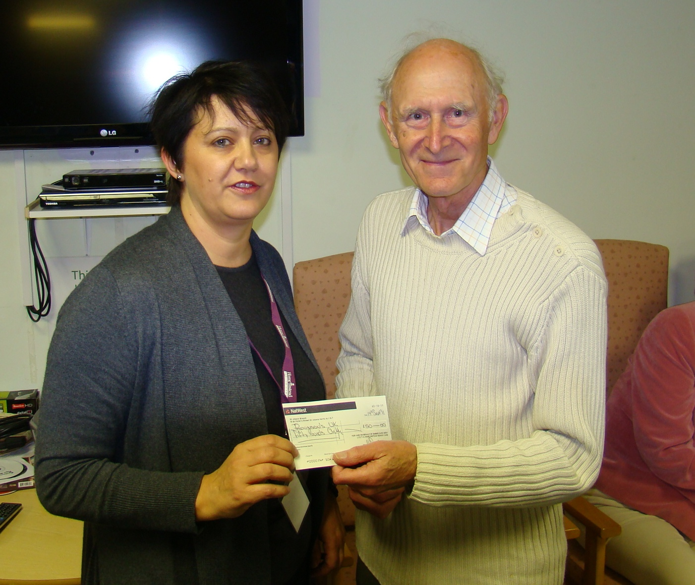 Home Instead Welwyn and Hatfield owner Heather Simms and Don Ellis, the Chairman of the Parkinson's UK Welwyn Hatfield Branch