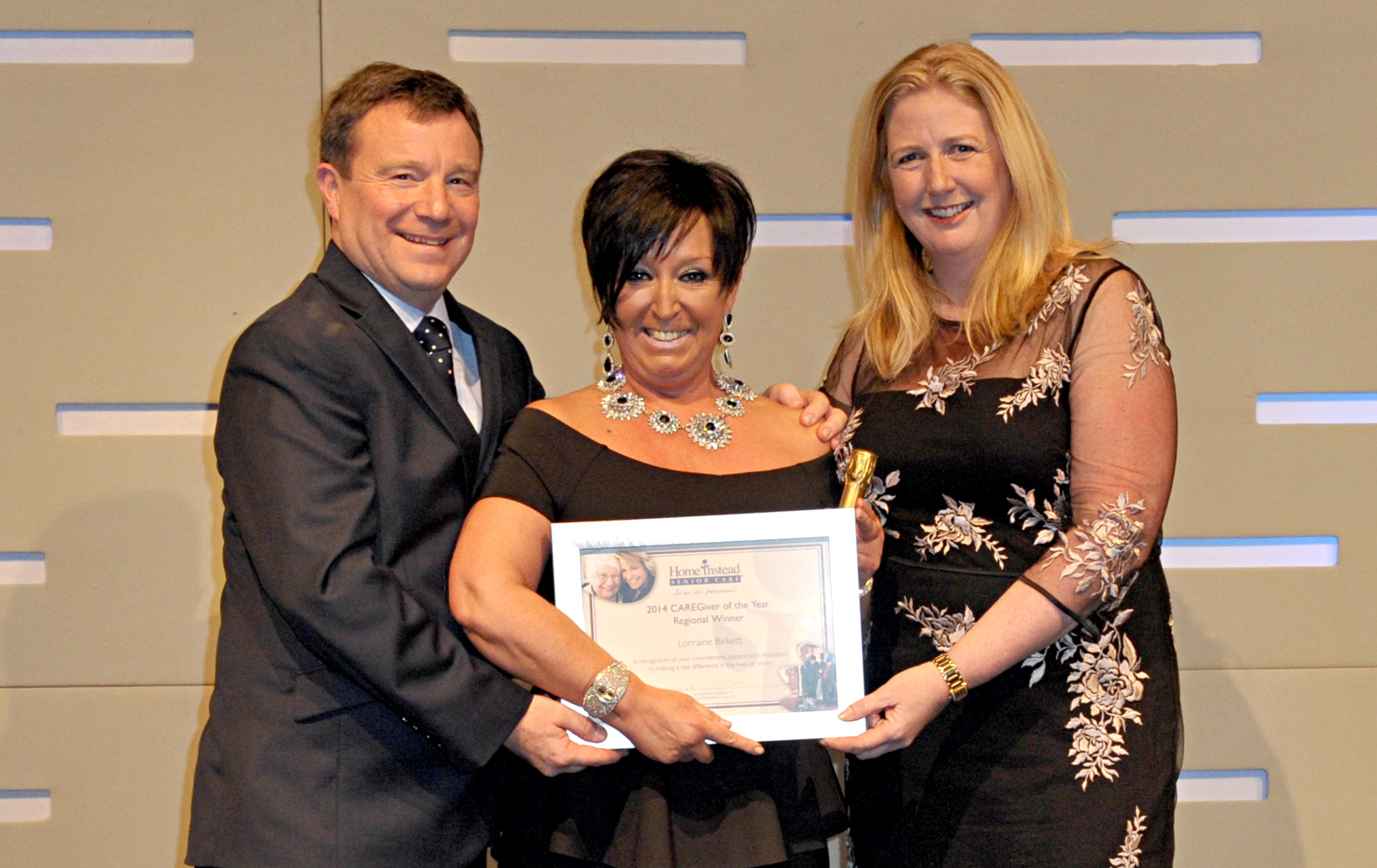 Home Instead Newcastle-upon-Tyne CAREgiver Lorraine Birkett receiving her '2014 Caregiver of the Year' award