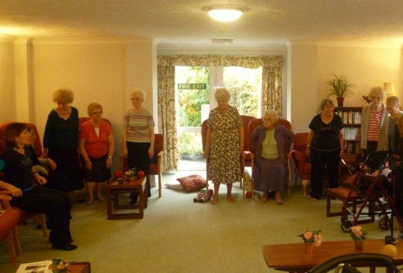 Residents at Holmdell House enjoying the Pilates class organised by Home Instead Senior Care St. Albans
