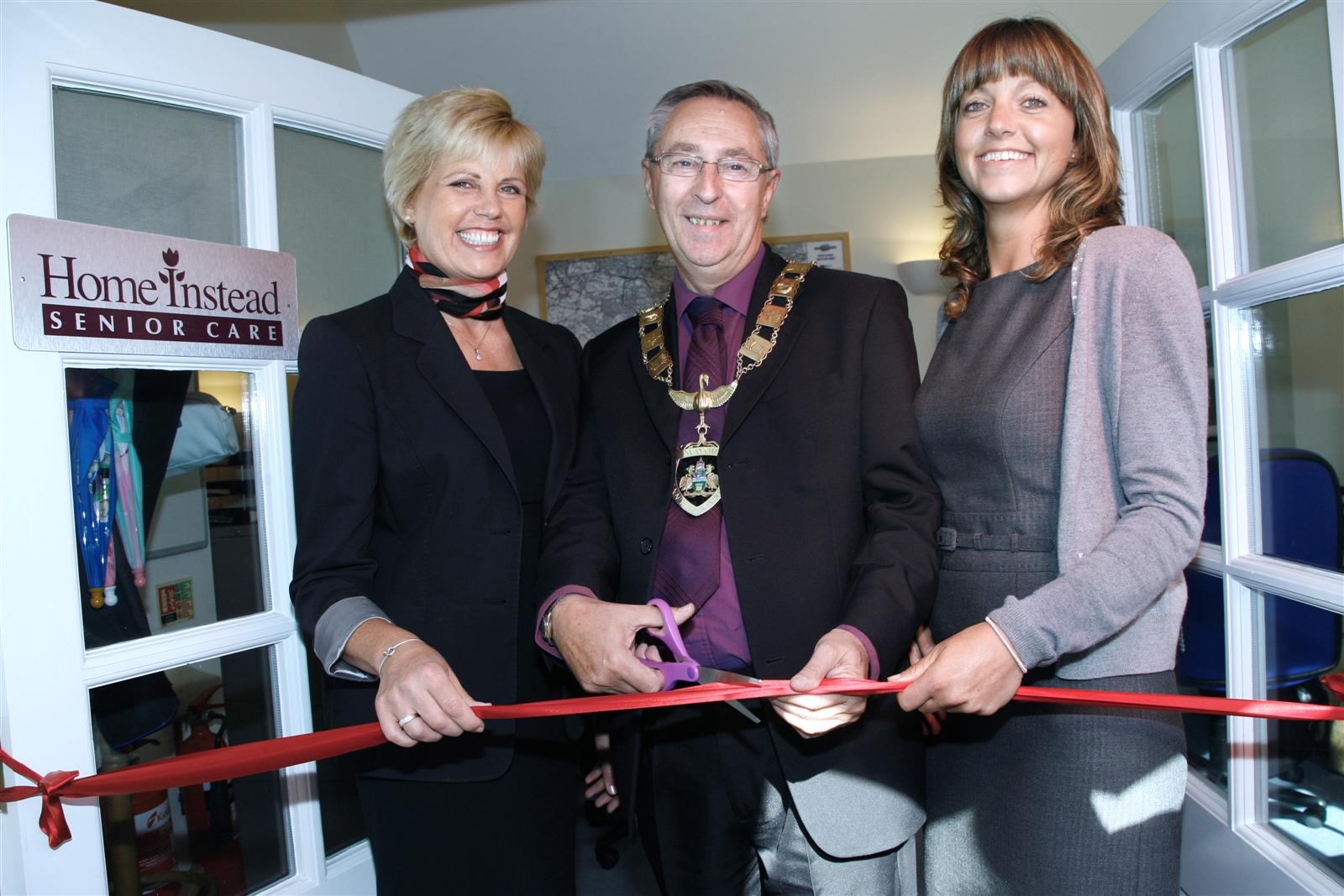 Home Instead Windsor and Runnymede owner Anitra Camargo and team member with Mayor of Runnymede, Councillor David Parr