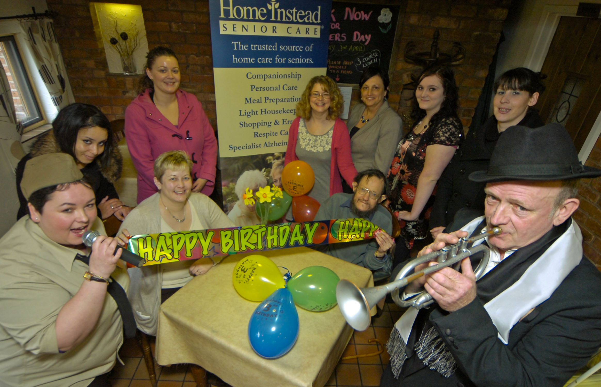 Home Instead Solihull CAREgiver Samantha Elliot and her singing group 'Something Special', celebrating the third anniversary of the franchise