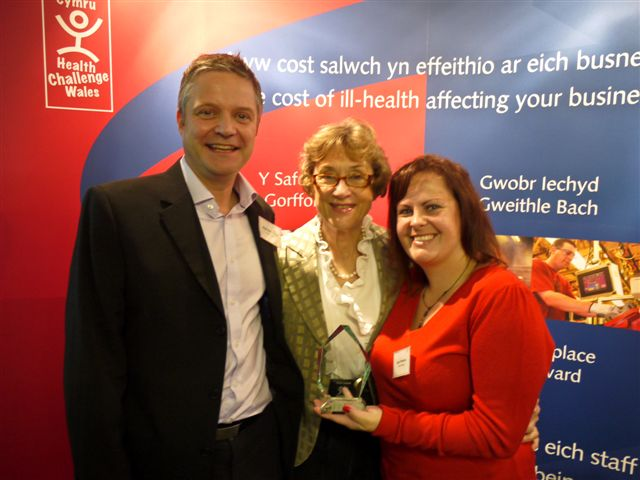 Home Instead Senior Care Cardiff office member receiving the Small Workplace Health Award by the Welsh Government