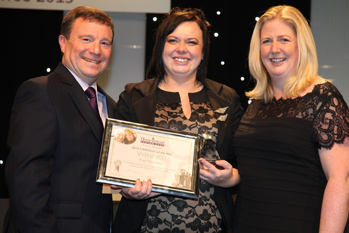 'Caregiver of the Year' award winner Kinga Drabrowska holding her title