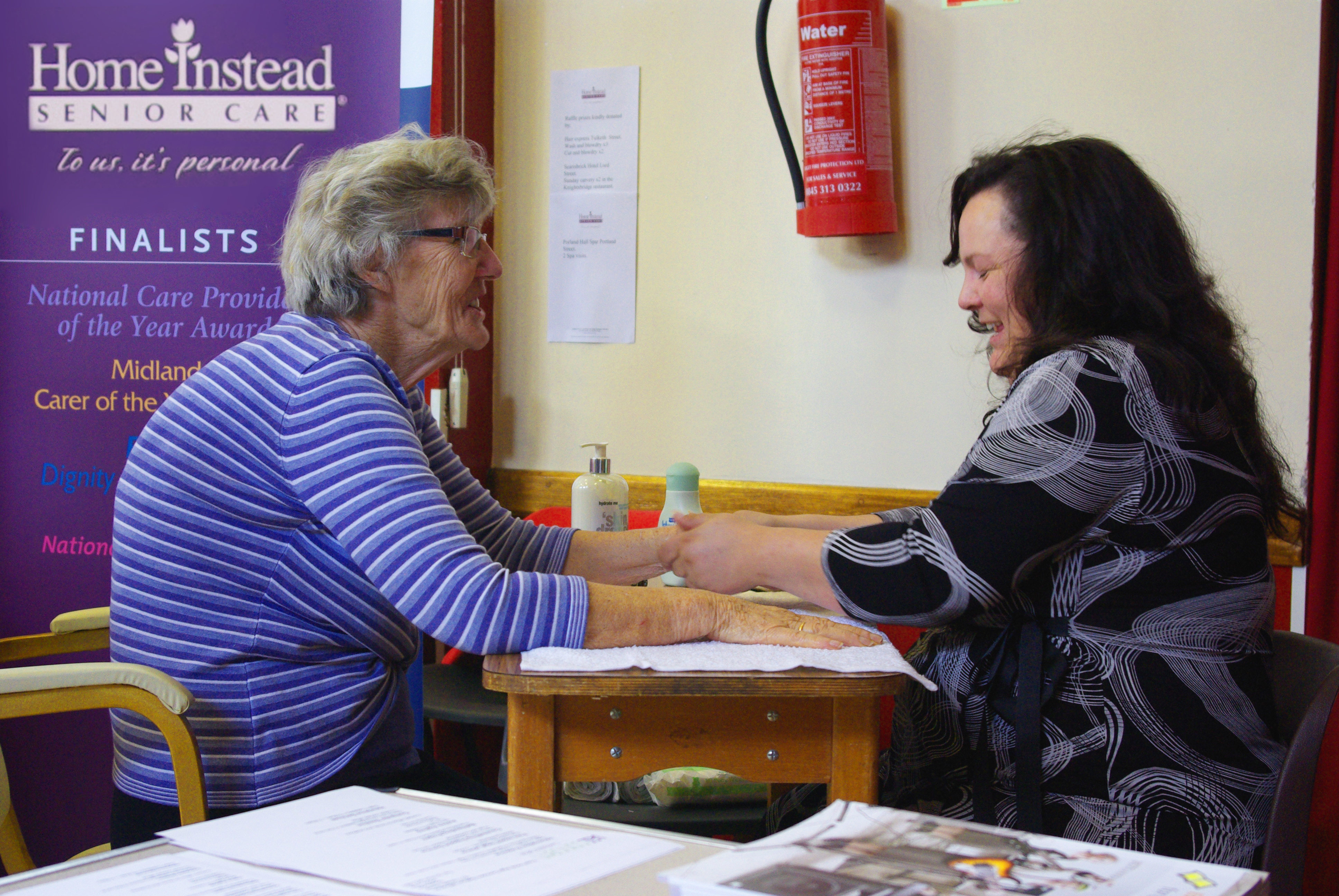 Home Instead Southport CAREgiver providing a massage to an elderly client on the Older Persons' Information Day