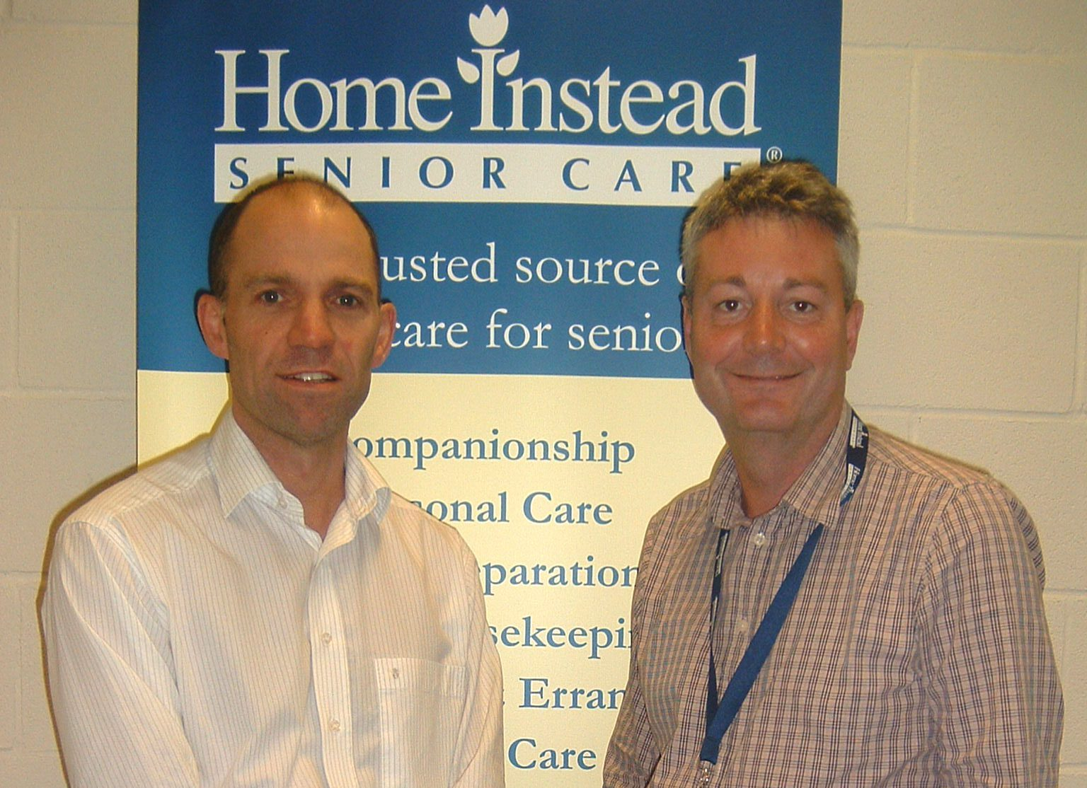 Home Instead Senior Care Derby South and Burton-on-Trent owners Andy Ryans and John Winfieldale after receiving their CQC Excellent rating