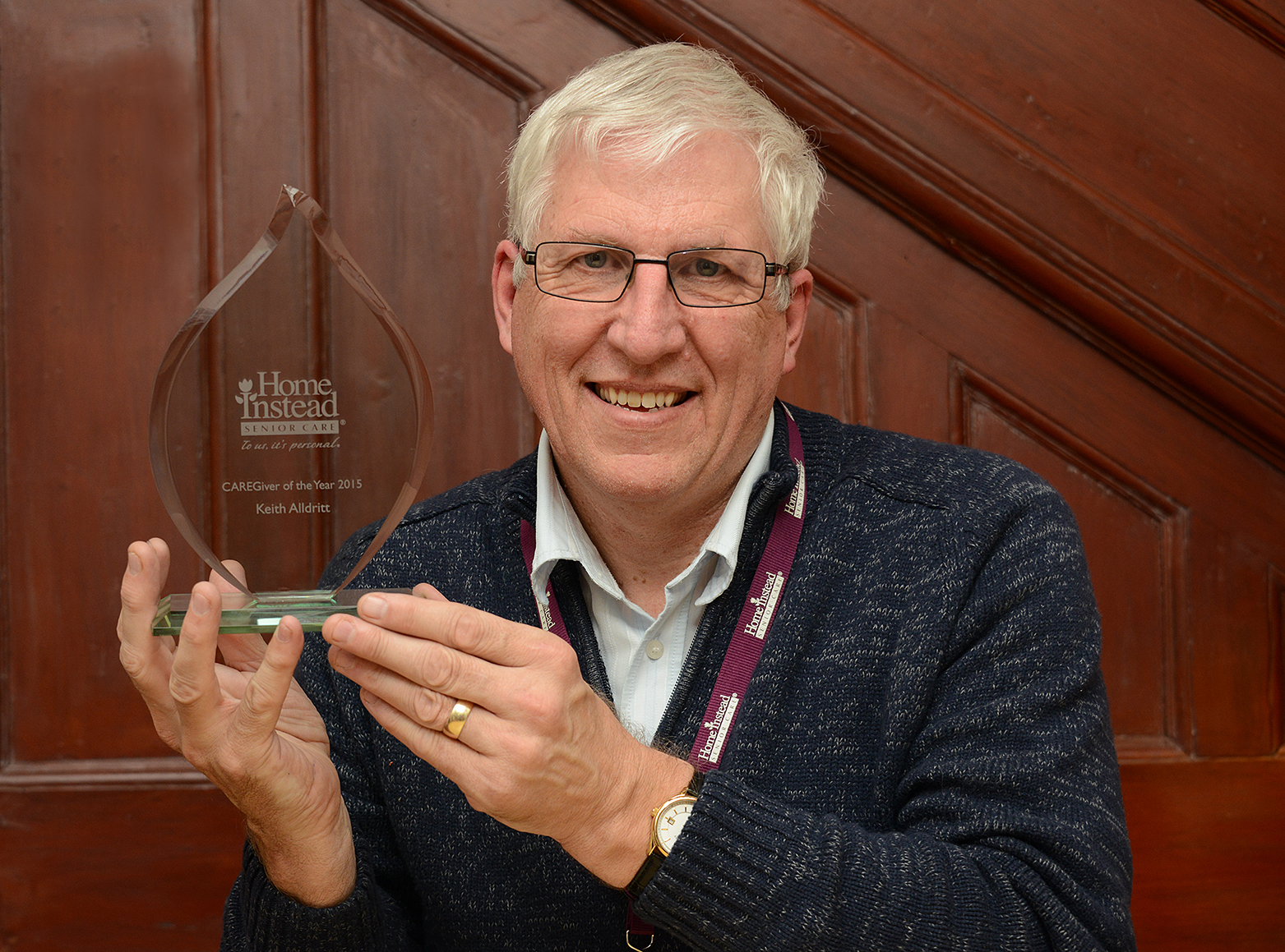 Home Instead Newcastle-under-Lyme CAREgiver Keith Alldritt holding his 'Caregiver of the Year' award