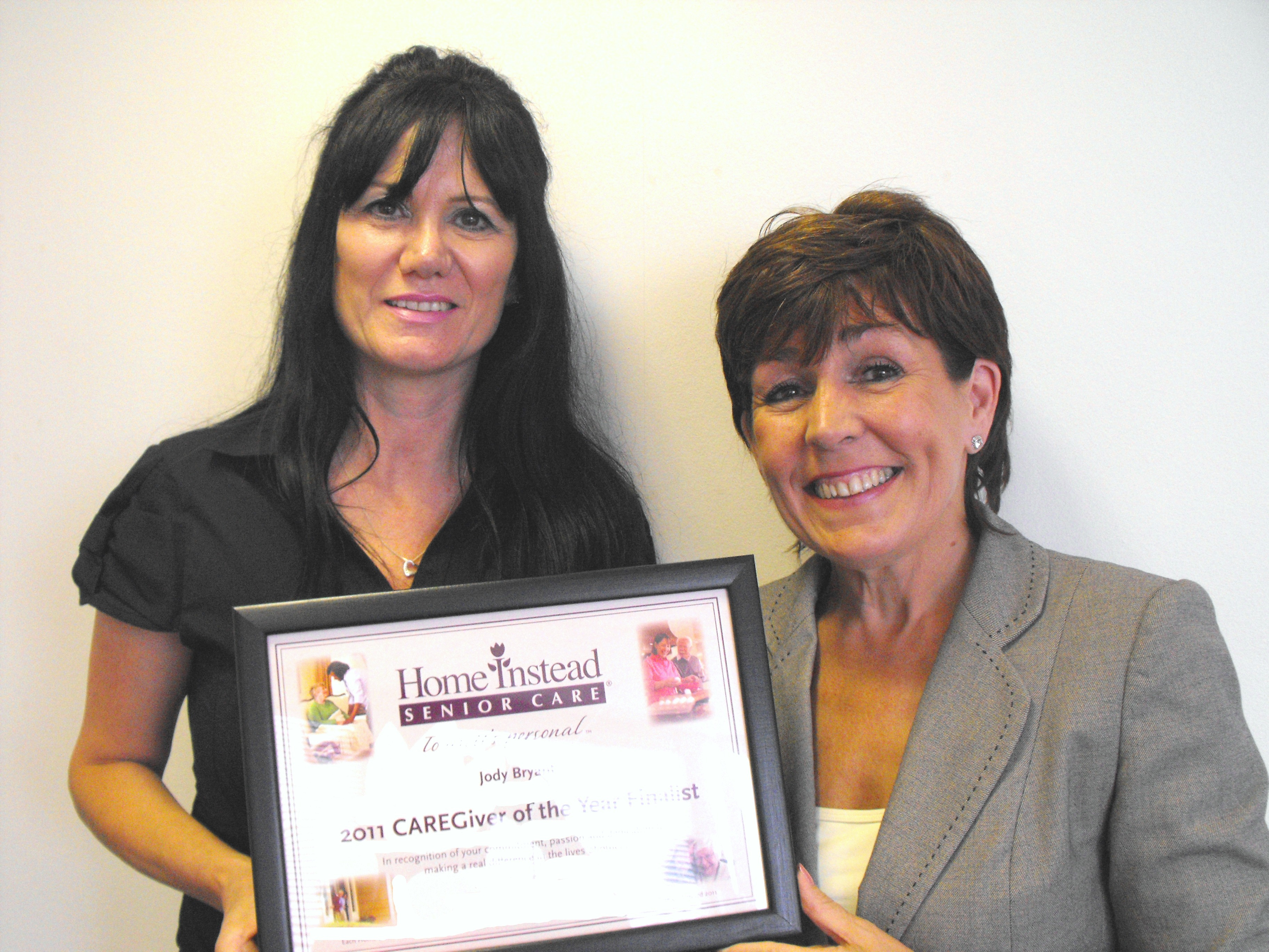 Finalist for 'Caregiver of the Year' and local elderly care provider Jody Bryant, holding her finalist certificate