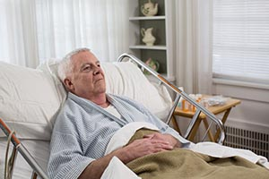 Elderly man at home, receiving personal care by Home Instead