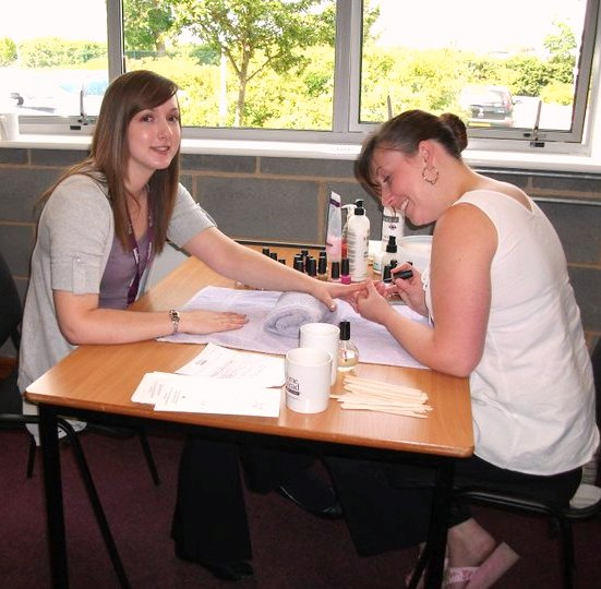 Home Instead CAREgiver East Northants Laura Bushby receiving a manicure at the pamper day