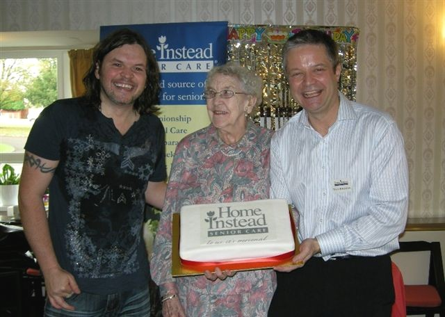 Local musician Leighton Jones celebrating Home Instead's client Audrey Black's 91st birthday along with owner Philip Batchelor