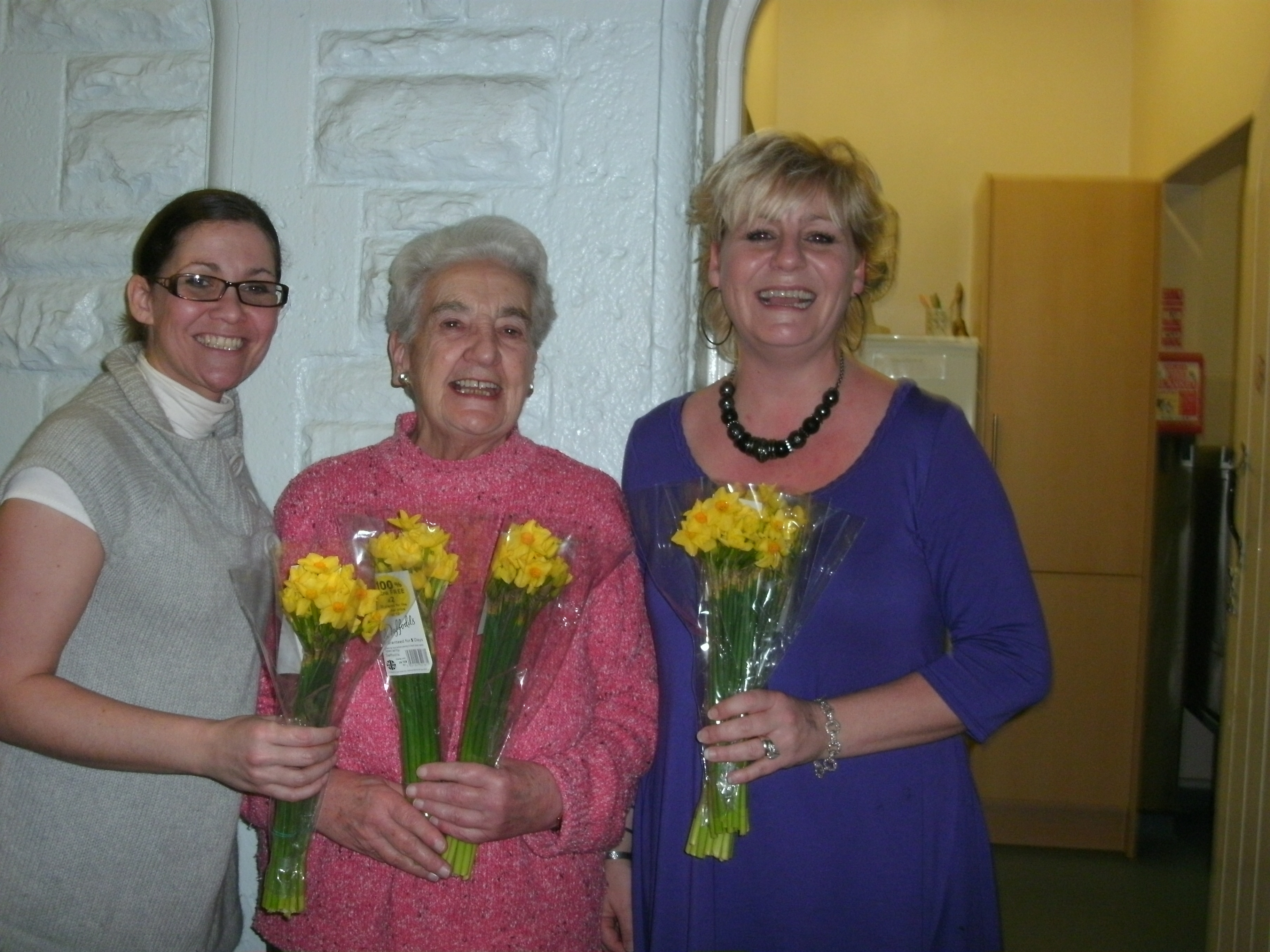 Home Instead employees Kylie Bishop, Dr Valerie Marshall, and Linda Bowhill during the Golden Daffodils event
