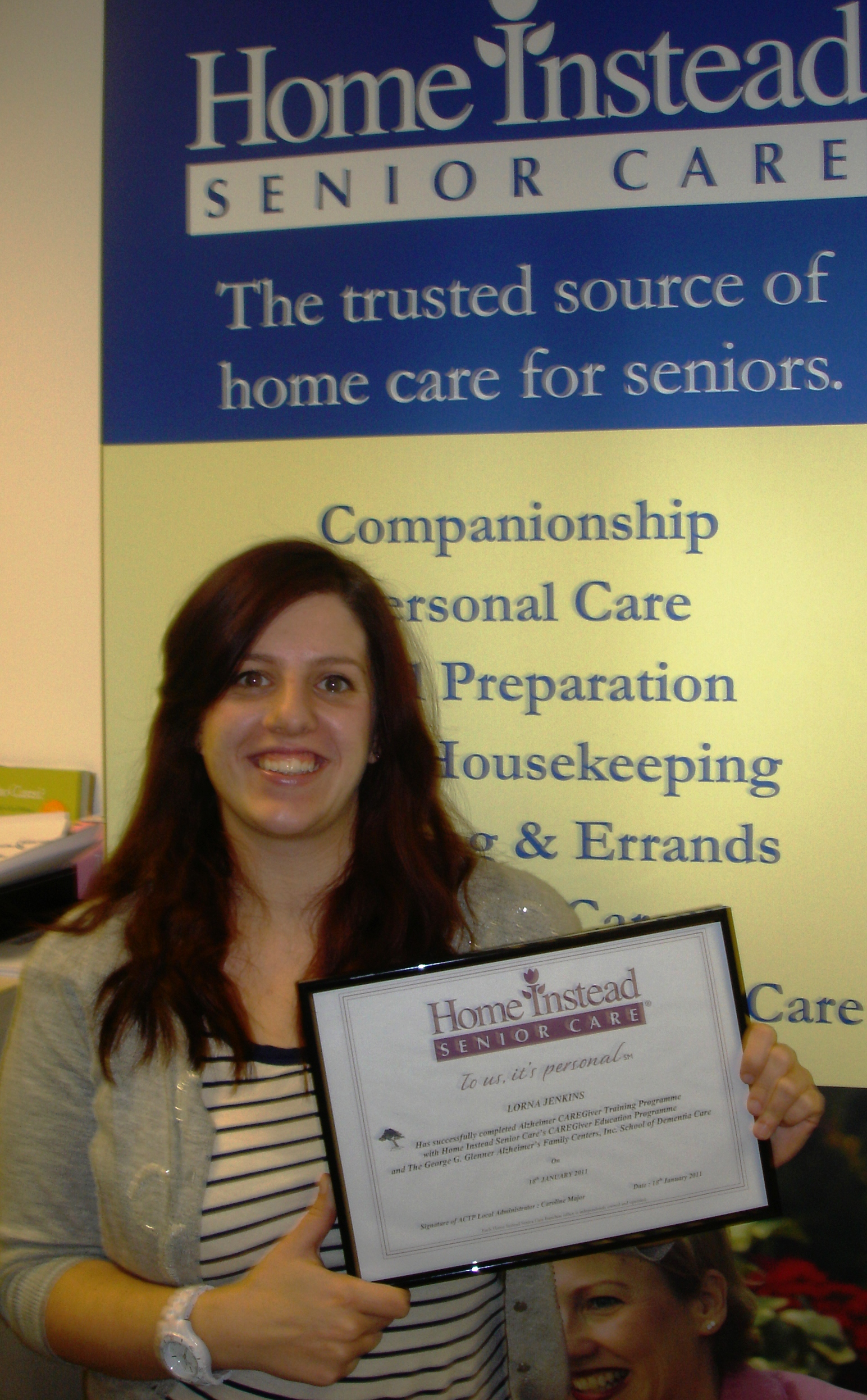 Home Instead High Wycombe CAREgiver Lorna Jenkins celebrating after completing a new 'Advanced Alzheimer's training programme'