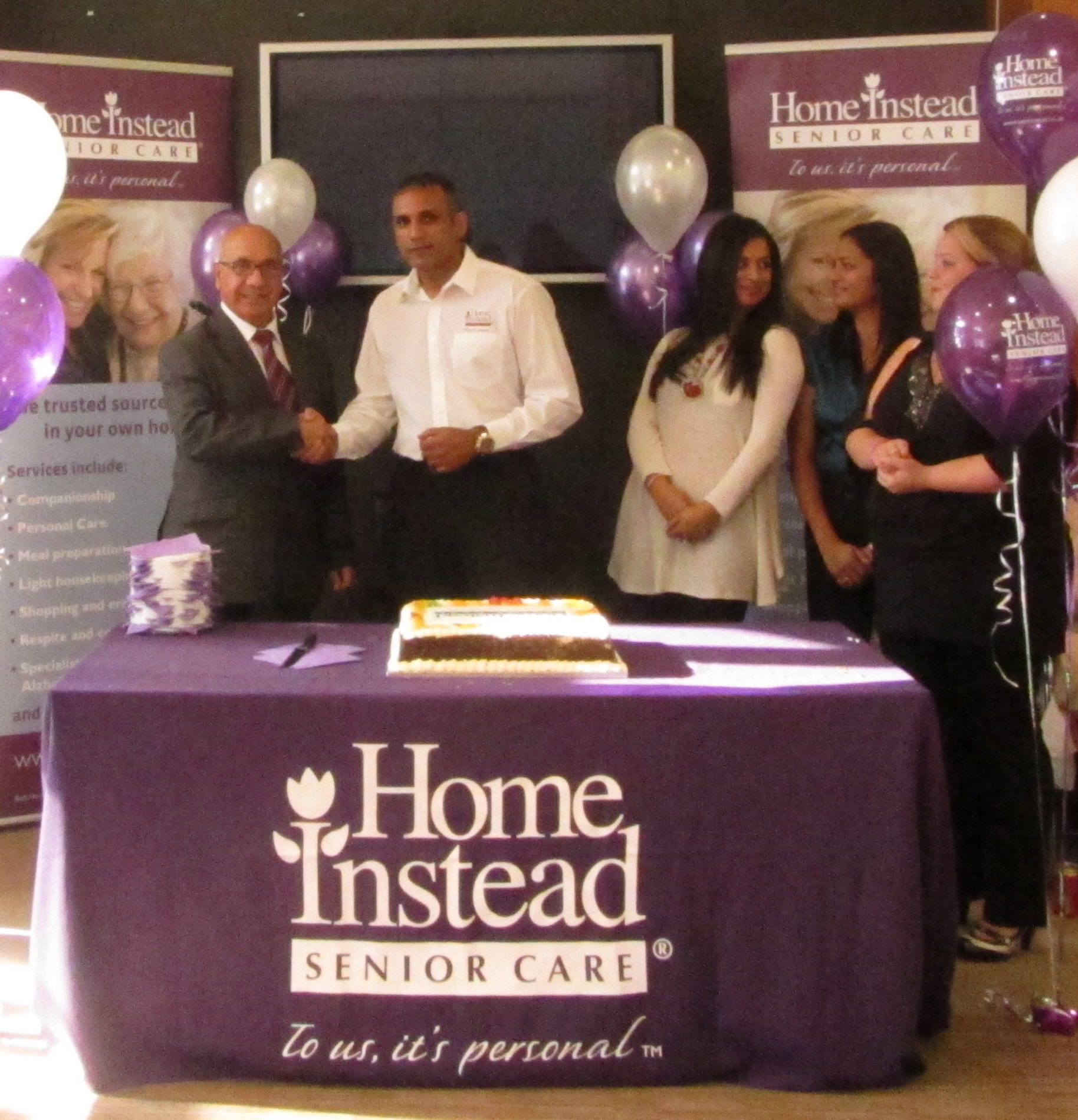Home Instead Ealing owner Tony Hussein and Ealing MP Virendra Sharma at Home Instead's open company day