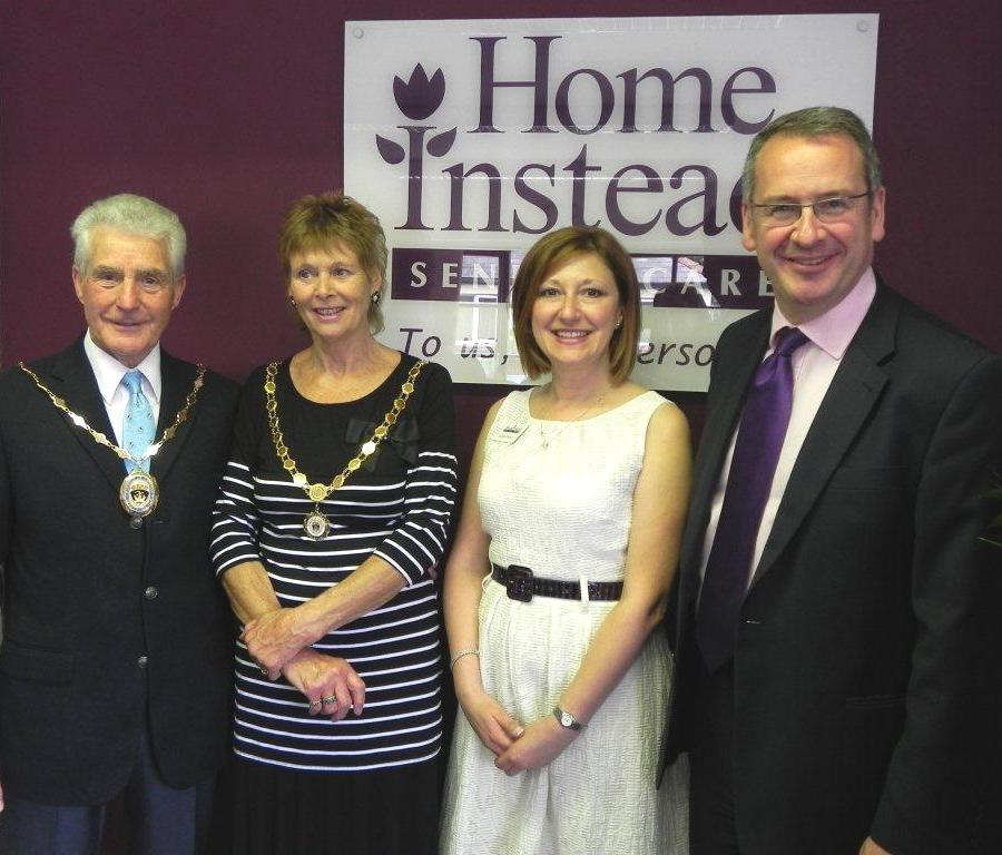 Deputy Mayor Dennis Steadman and his wife Carole, Home Instead Southampton East owner Luisa Castle and Mark Hoban MP celebrating the franchise's first anniversary