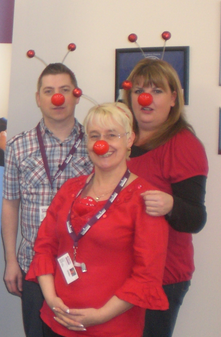 Home Instead Warrington team members supporting Comic Relief by wearing red noses