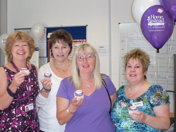 Home Instead Ipswich office team celebrating their second birthday with personalised cupcakes