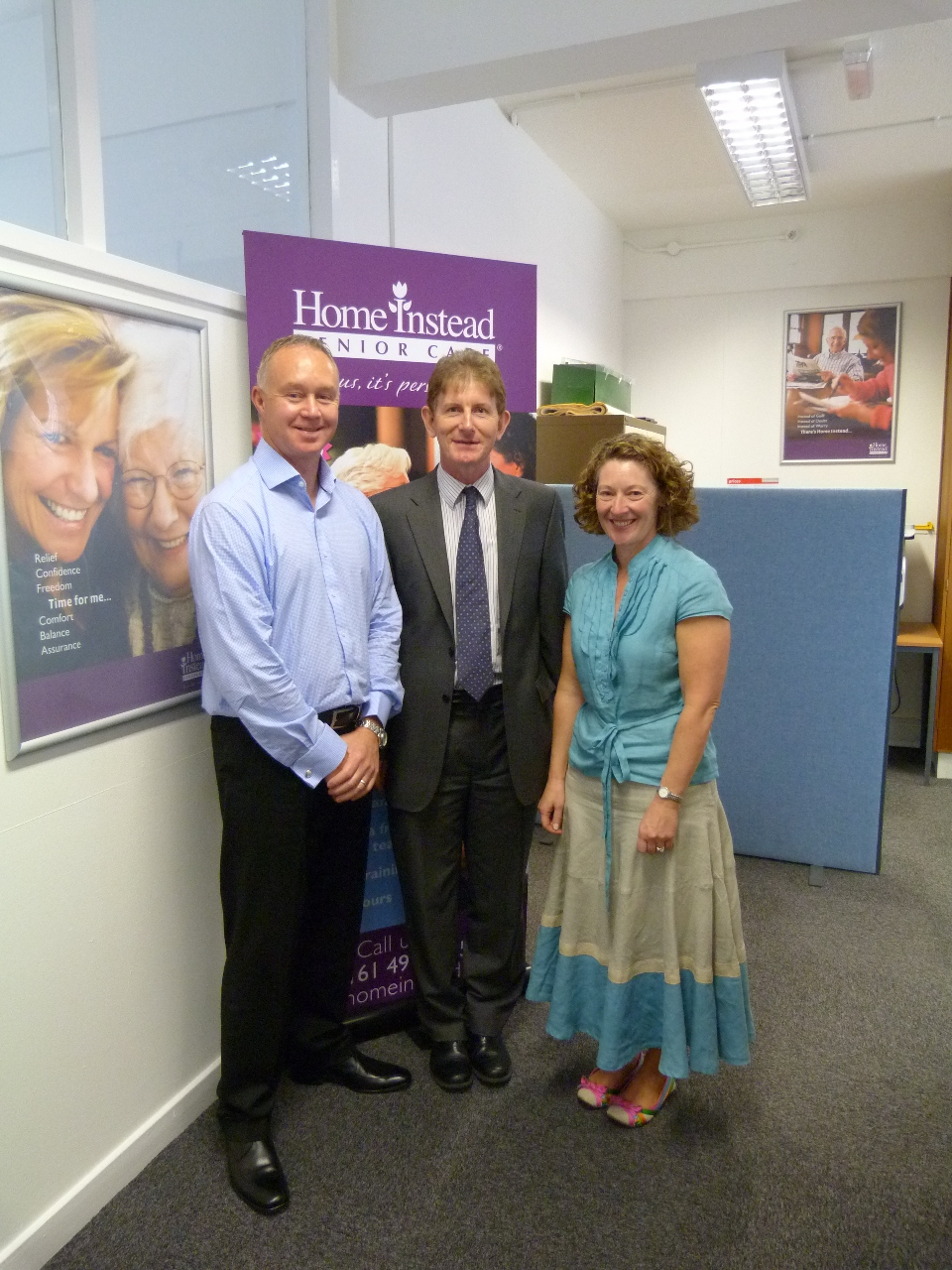 Robert Devereux, Permanent Secretary at the Department for Work and Pensions (DWP), being greeted by Home Instead Stockport owners David and Joanna Moore